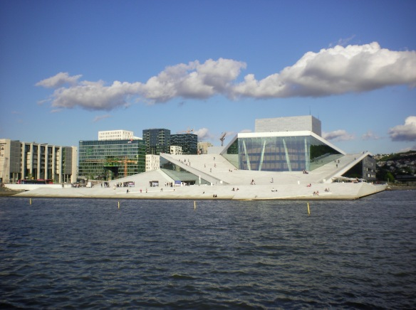 The Oslo Opera house resembles a glacier floating in the bay