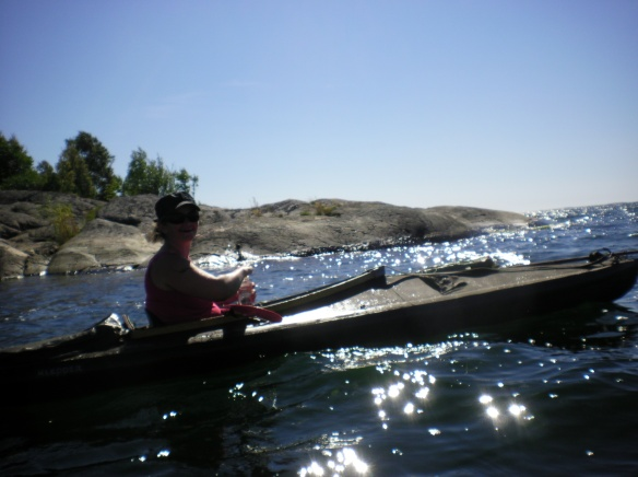 Ulsa riding the wooden Kayak