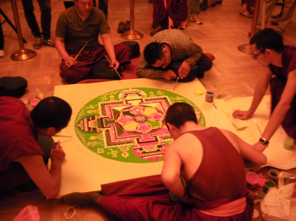 Tibetan lamas at work on the Mandala