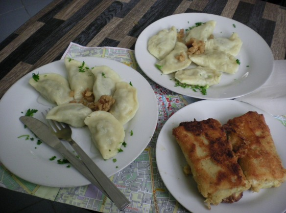 Two types of Perogis (dumplings) Polish and Russia, followed by a deep fried pancake filled with sauerkraut