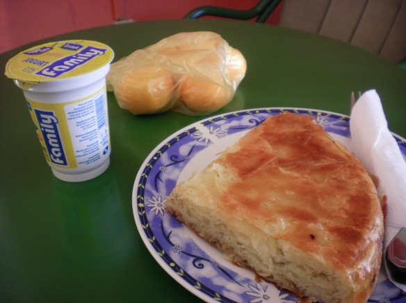 "My favorite Serbia breakfast, ""Burek"" and yogurt. Layers filo dough, with cheese and meat., fresh out of the oven"