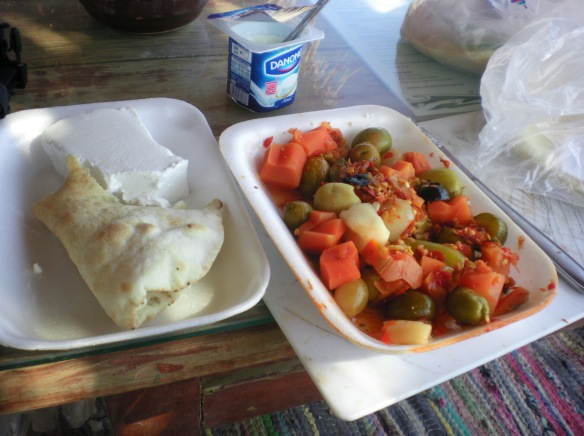 Standard Egyptian breakfast, Aiesh (Pita bread), Behoney ( fermented vegetables) and yogurt