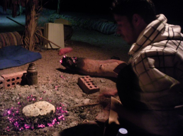 Salah, my Bedouin friend makes me tobania, fire bread with spices