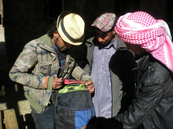 Bedouin guides pack me sleeping bag, thermarest and stove for the trek to Mt. Moses