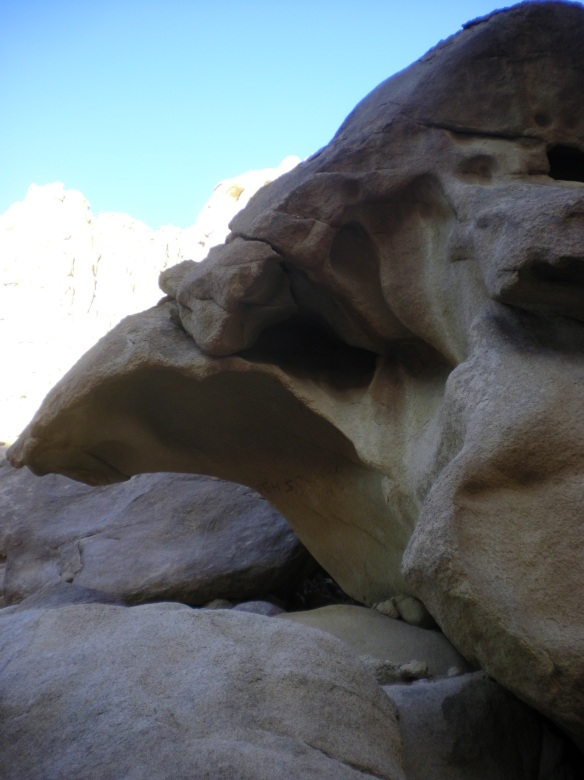 Rocks worn by the floods, climbing through a crevice on route to the summit