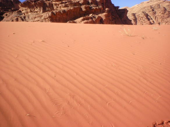 Wind carved sand, follows the paved highways throughout southern Jordan