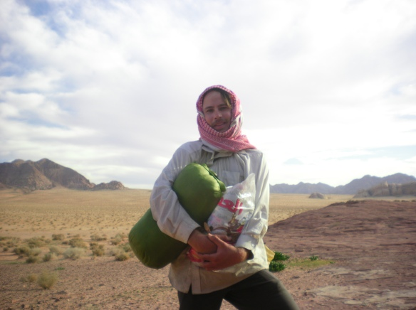 The only thing that you can't buy at an REI or camping equipment store is the most important thing, will power. Pannier over my shoulder, sleeping bag and plastic bag full of water I walked over 30 km in the sandy deserts of Wadi Rum