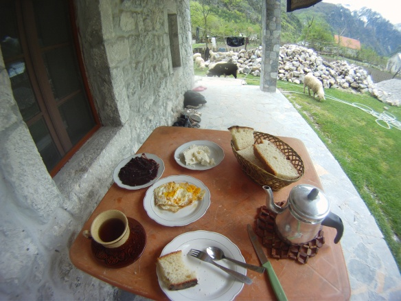 Albanian mountain breakfast; home baked bread, sheep cheese, marmalade, deep fried eggs and mountain tea