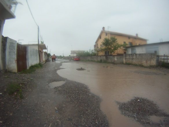 Rain in the village of Koman