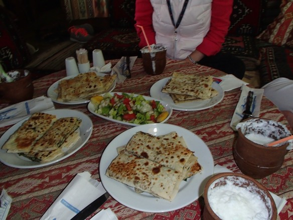 Eastern Turkish Cuisine, Gozleme, fresh bread with eggplant and cheese, very similar to a quesadilla. Washed down with ayran, the salty Turkish Lassie equivalent.