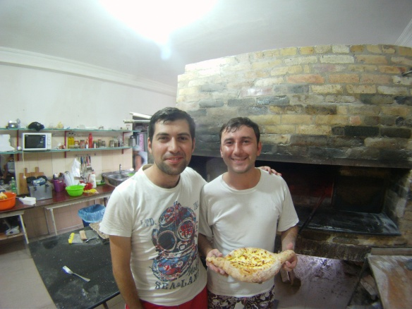 Some friendly Georgians showing off a freshly made acharuli