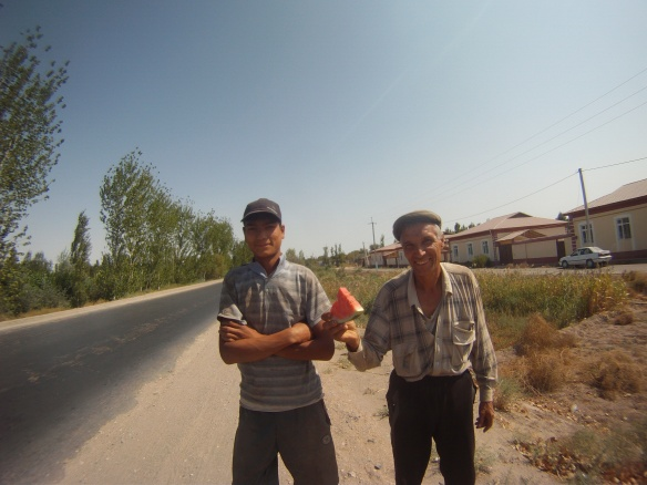 Locals coming to the roadside and offering watermelon in the intense heat