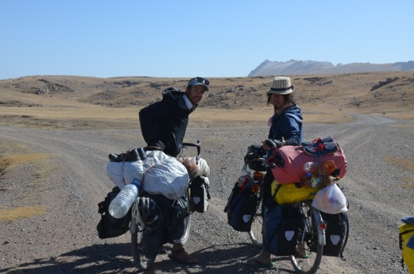 Lost pictures from Song Kol. Two Asians with a similar packing style, my bike probably weights 20 kilos less than Kei's.