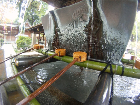 Traditional fountain found outside the local Jinja (Shrine) in Fukuoka. The Japanese practice a washing process similar to that of the Islamic tradition