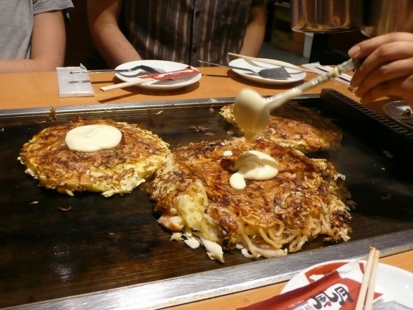 Oconomi Yaki, Hiroshima specialty. Bean sprouts, Noodles, pancake, egg and bacon
