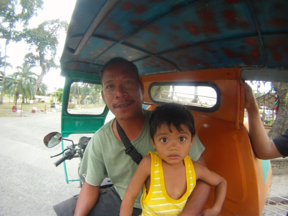 Julio and his son Angelo, another friendly tricycle driver