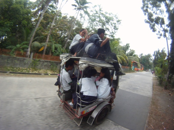 Tricycle filled with school children