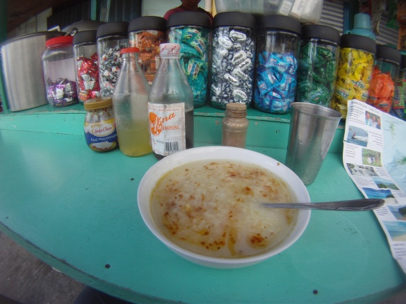Rice soup and chili sauce breakfast