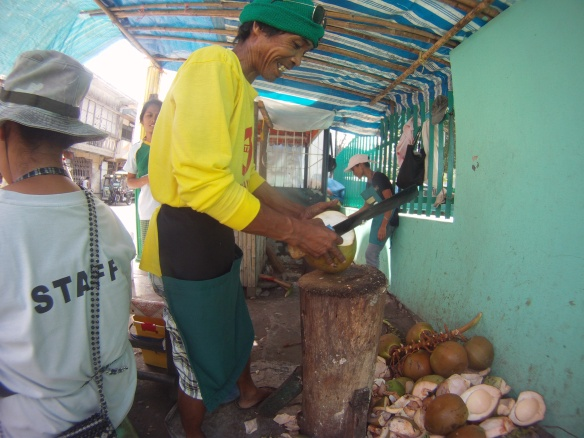 Local man prepares fresh coconut juice