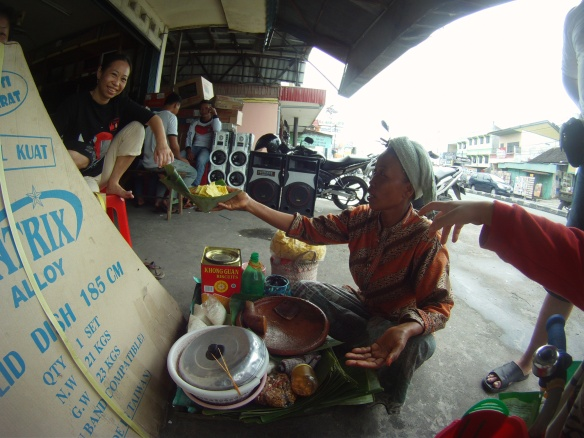 """Gado Gado"" lady. She walks around the city of Balikpapan with this tray on her head making fresh peanut sauce, with rice cake and vegetables"