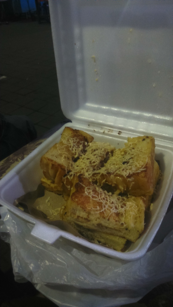 Roti Panggang. Grilled cheese sandwich with caramel topping. Local Balinese snack found at the Pasar.