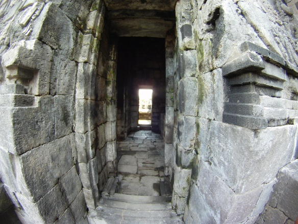 Old rock entrance and long dark hallways