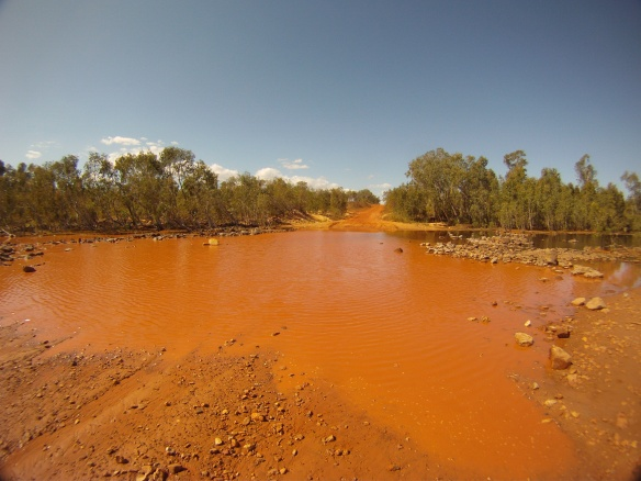 Dangerous creek crossing. This one was at least a half meter deep with zero visibility in crocodile territory!